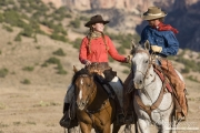 Flitner Ranch, Shell, WY - cowboy and cowgirl riding hand in hand